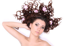 Brunette woman lying with flowers Royalty Free Stock Photo