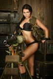 Brunette woman with machine gun Royalty Free Stock Image