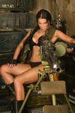 Brunette woman with machine gun Royalty Free Stock Photo