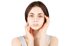 Brunette woman with  marks on face on white. Plastic operation concept - brunette woman with  marks on face Royalty Free Stock Images