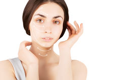 Brunette woman with  marks on face on white. Plastic operation concept - brunette woman with  marks on face Stock Image