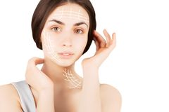 Brunette woman with  marks on face on white. Plastic operation concept - brunette woman with  marks on face Stock Photos