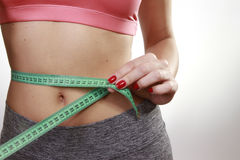 Brunette woman measuring her belly Stock Image