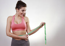 Brunette woman measuring her body Royalty Free Stock Images