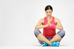 Brunette woman meditating after exercise Royalty Free Stock Photos