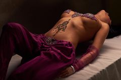 Brunette woman with mehendi on her stomach Stock Images
