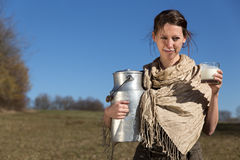 Brunette woman with milk jug and glass Royalty Free Stock Images