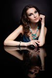 Brunette woman and mirror Royalty Free Stock Images