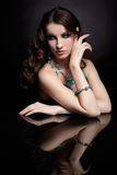 Brunette woman and mirror Royalty Free Stock Photography