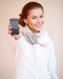 Brunette woman with mobile phone Royalty Free Stock Photography