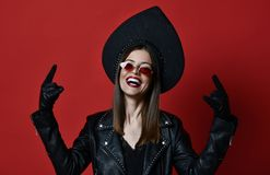 Brunette woman with mustaches in new brown modern fashion sunglasses stock photo