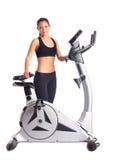 Brunette woman near bike  exerciser Stock Image
