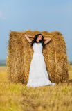 Brunette woman near hay bale Royalty Free Stock Image
