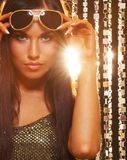 Brunette woman in the night club. Attractive brunette woman in the night club royalty free stock photography