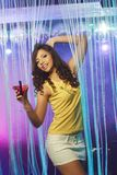 Brunette woman at the night club Stock Photos