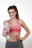 Brunette woman offering water and smile Royalty Free Stock Image