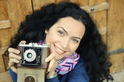 Brunette woman with old film photo camera collection Royalty Free Stock Photos