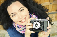 Brunette woman with old film photo camera collection Royalty Free Stock Image