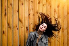 Brunette woman outdoor with blowing up hair stock image