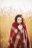 Brunette woman outdoors in check pattern plaid smiling Stock Images
