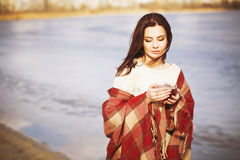 Brunette woman outdoors in check pattern plaid smiling Stock Photo