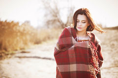 Brunette woman outdoors in check pattern plaid smiling Royalty Free Stock Photography
