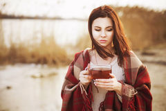 Brunette woman outdoors in check pattern plaid smiling Royalty Free Stock Images