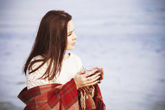Brunette woman outdoors in check pattern plaid smiling Stock Image