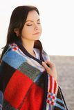 Brunette woman outdoors in check pattern plaid Royalty Free Stock Image