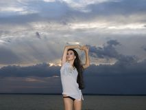 Brunette woman over dusk sky at sunset Royalty Free Stock Images