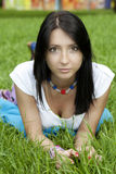 Brunette woman in park Stock Images