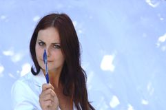 Brunette woman with pen Royalty Free Stock Images