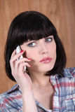 Brunette woman at phone. Brunette woman on the phone royalty free stock images