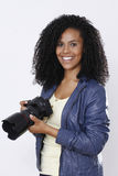 Brunette woman photographer Stock Image
