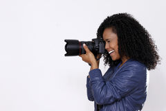 Brunette woman photographer Stock Photography