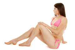 Brunette Woman Pink Bikini Sit Look To Side Royalty Free Stock Images