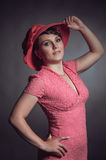 Brunette woman in pink dress Royalty Free Stock Photos