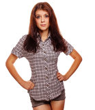 Brunette woman in a plaid shirt and jeans shorts Royalty Free Stock Image