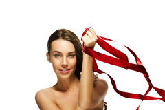 Brunette woman playing with a red ribbon Royalty Free Stock Photos