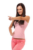 Brunette woman pointing portrait Stock Photography