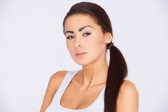 Brunette woman with ponytail haircut Royalty Free Stock Photography