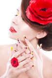 Brunette woman with poppy flower in her hair, poppy ring and creative nails, closed eyes Royalty Free Stock Photos
