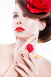 Brunette woman with poppy flower in her hair, poppy ring and creative nails, closed eyes Stock Image