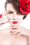 Brunette woman with poppy flower in her hair, poppy ring and creative nails, closed eyes Stock Photography