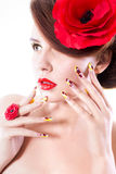 Brunette woman with poppy flower in her hair, poppy ring and creative nails Stock Photos