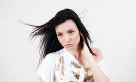 Brunette woman portrait. Brunette sensual model posing fashion on white background Royalty Free Stock Photos