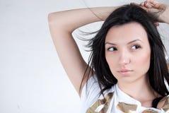 Brunette woman portrait. Brunette sensual model posing fashion on white background Royalty Free Stock Images