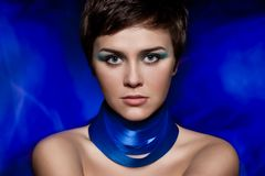 Brunette woman portrait with blue makeup Royalty Free Stock Images