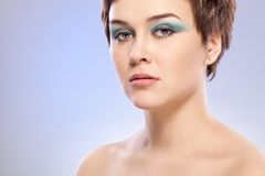 Brunette woman portrait with blue makeup Royalty Free Stock Photography