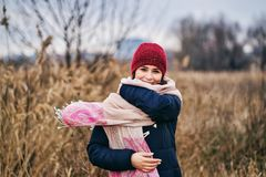 Woman smiling in cold weather royalty free stock photography